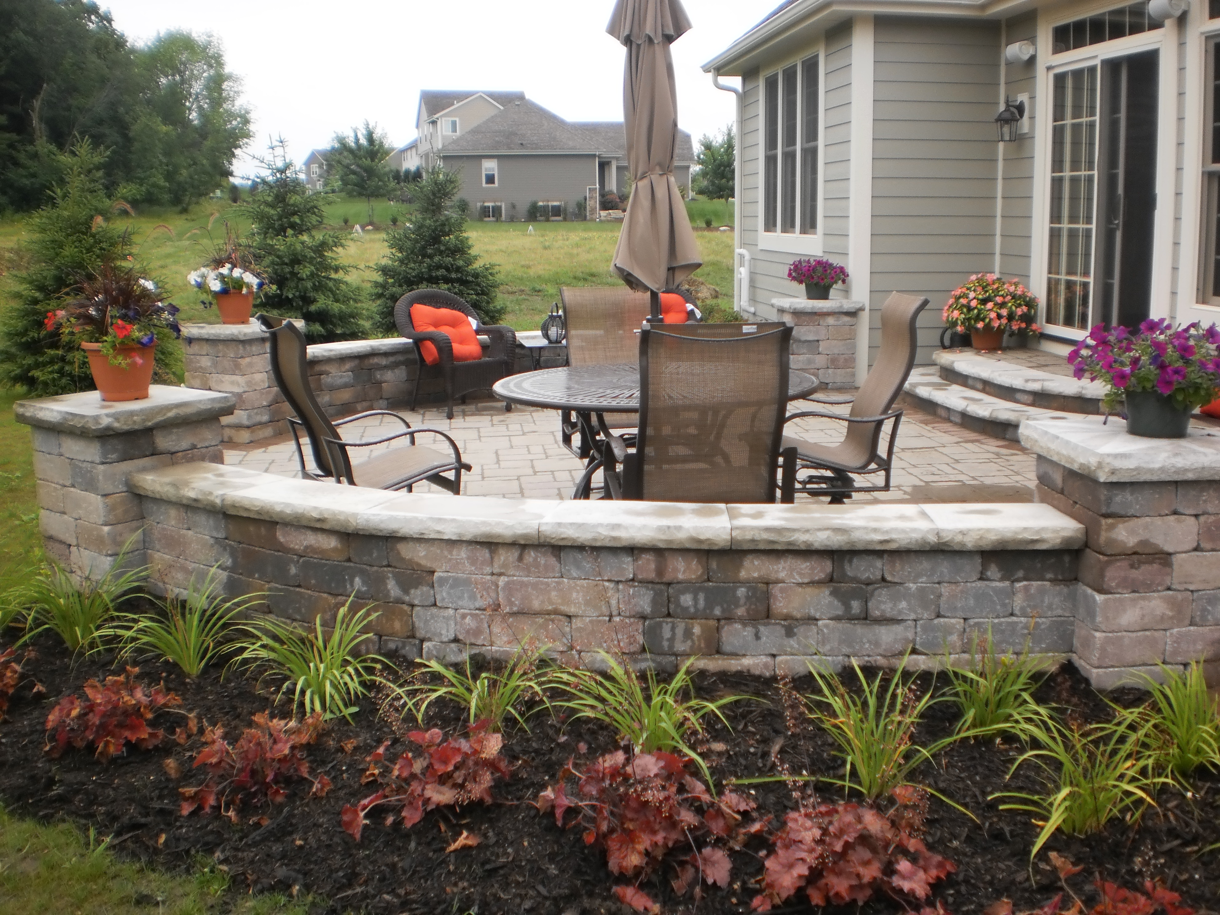 ... Flagstone Patio, Or Natural Stone/interlock Retaining Wall, Trees On  The Move Can Design And Install Hardscapes To Coordinate With Your Total  Landscape ...
